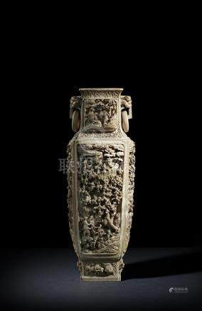 λ A massive 19th century Chinese ivory vase, the rectangular body finely and elaborately carved,