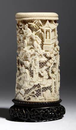 λ A late 19th century Chinese Canton carved ivory tusk vase, with a reticulated ground and decorated