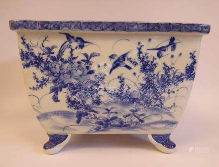 A 20thC Japanese porcelain rectangular planter, on stubby feet,