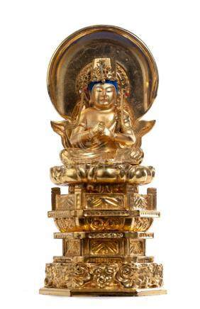 Statuette de Kannon en bois doré laqué.