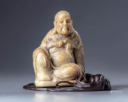 A Chinese soapstone  figure with a zitan wooden stand