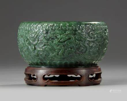 A Chinese spinach green jade 'nine dragons' bowl