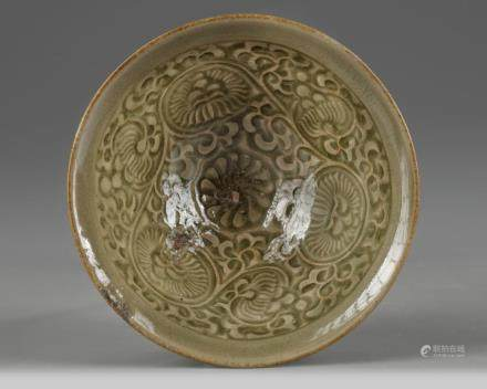 A Yaozhou celadon-glazed 'chrysanthemum scroll' bowl