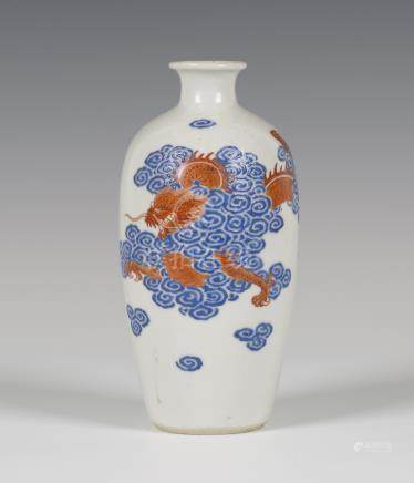A Chinese blue enamelled and iron red painted porcelain vase, Jiaqing period, the elongated ovoid