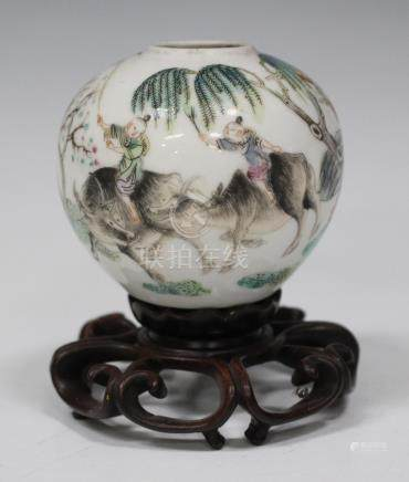 A Chinese famille rose porcelain globular water coupe, Republic period, painted with two boys on