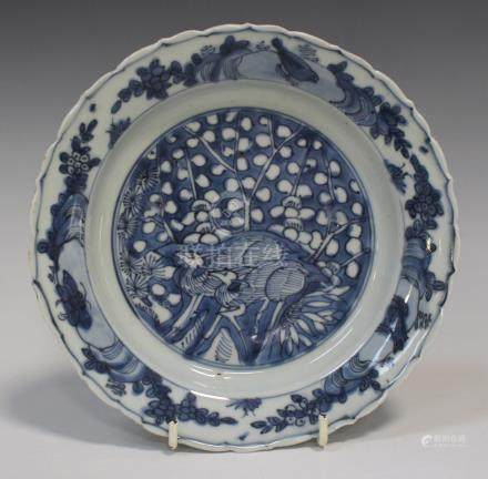 A Chinese blue and white Kraak porcelain plate, Wanli period, painted with two deer and prunus,