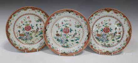 A set of three Chinese famille rose export porcelain plates, Qianlong period, each painted with a