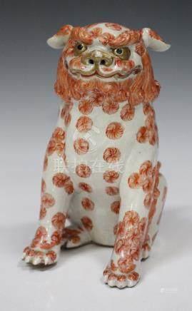 A Japanese Kutani porcelain figure of a Karashishi, Meiji period, the lion dog modelled in a