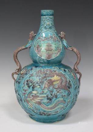 A Chinese turquoise and aubergine enamelled biscuit porcelain double gourd shaped vase, mark of
