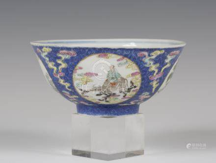 A Chinese famille rose enamelled blue ground medallion bowl, mark of Qianlong but late Qing dynasty,