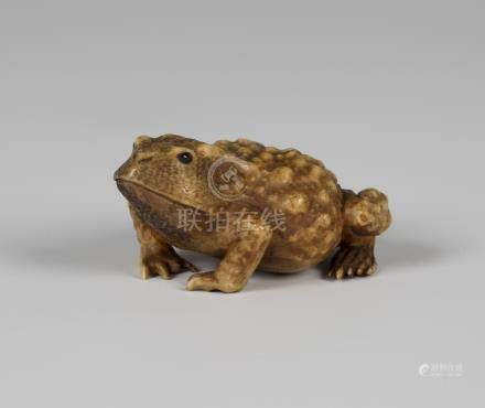 A Japanese carved staghorn okimono, Meiji period, finely modelled in the form of a toad, unsigned,
