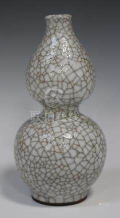 A Chinese crackle glazed double gourd vase, 20th century, the pale grey glaze with all-over crackle,