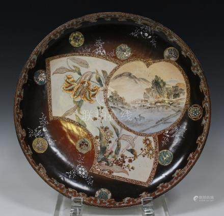 A Japanese Satsuma earthenware circular dish, Meiji period, the interior painted with two fan shaped
