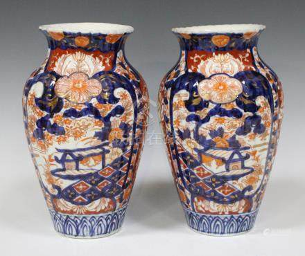 A pair of Japanese Imari vases, Meiji period, of high shouldered ribbed form, decorated with