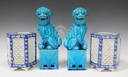 A pair of Chinese turquoise glazed Buddhistic lions, 20th century, typically modelled raised on