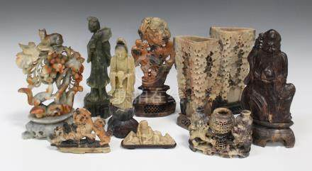 A collection of Chinese soapstone carvings, mostly early 20th century, the majority spill vases