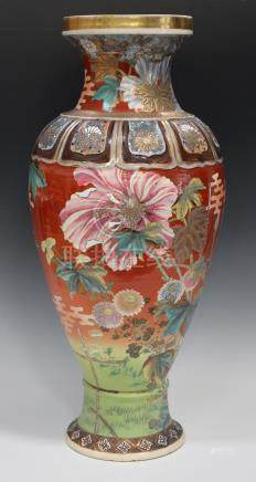 A Japanese Satsuma earthenware vase, Meiji period, the ovoid body painted and gilt with birds,