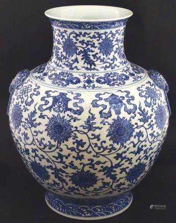 A large Chinese blue and white vase, depicting scrolling lotus with shou character to centre flower,