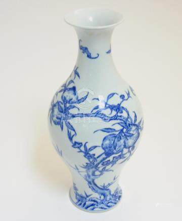 A Chinese blue and white 'Bat and Fruit' vase,