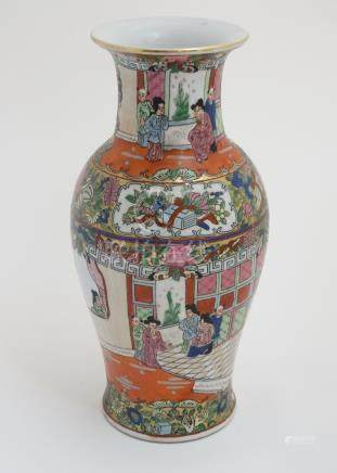 A Chinese famille rose flared rim vase in a Cantonese style ,