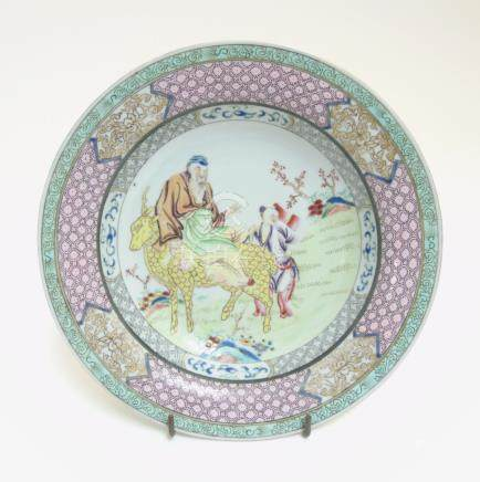 A Chinese Famille Rose plate with a figure on a yellow coloured deer together with a child to