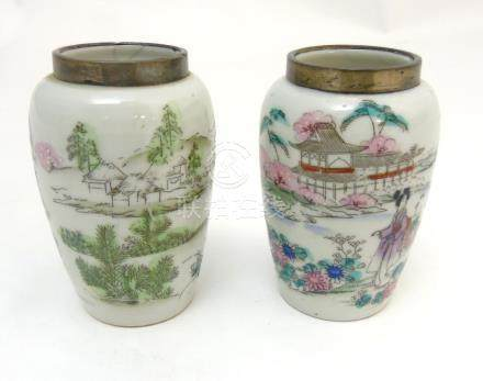 A pair of Chinese famille rose vases with silver rim,