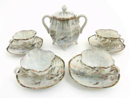 A Japanese part tea set, comprising a two handled sugar bowl and cover,