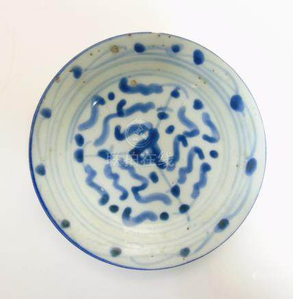 An Oriental, possibly Japanese small dish in underglaze blue,