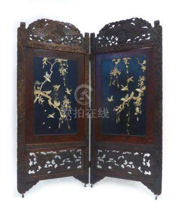 A late 19th/early 20th century Japanese carved and lacquer work two section screen relief decorated