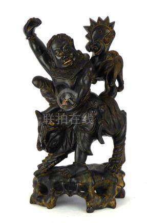 A Chinese hardwood carving modelled as figure riding a qilin, h.