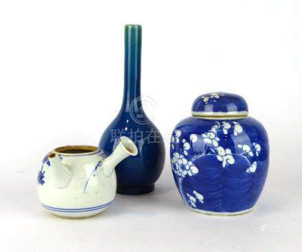 A Chinese stoneware bottle vase decorated in a plain kingfisher blue glaze, h.