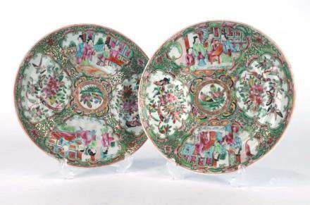 A near pair of Cantonese side plates of circular form typically decorated with traditional scenes,