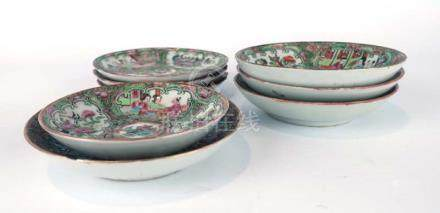 A group of nine Cantonese saucers and saucer dishes typically decorated with traditional scenes,