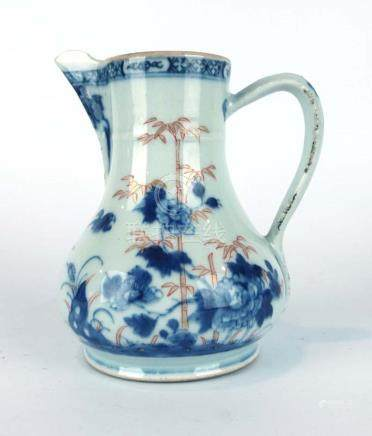 A late 18th century water jug of pear shaped form decorated in the Imari palette with bamboo and