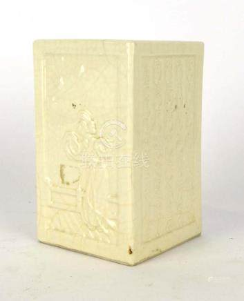A Chinese slab vase relief decorated with script and traditional figures in a plain cream glaze,