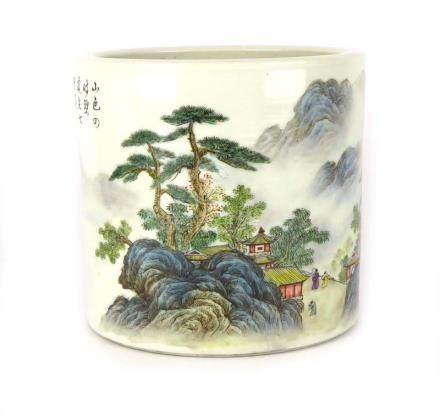 A Chinese cylindrical vase/pot painted in coloured enamels with a traditional landscape and script