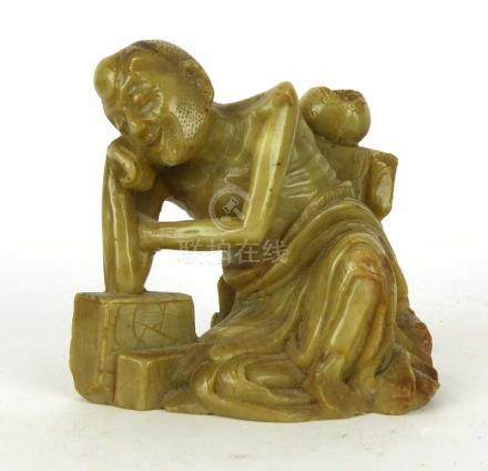 A Chinese hardstone carving modelled as an emaciated man, possibly Shakyamuni, h. 8.