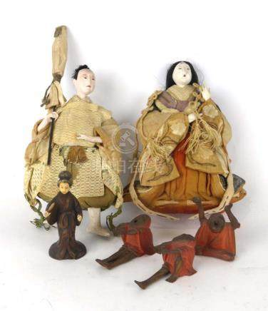 A pair of 19th century Chinese dolls modelled as an empress, h. 16.