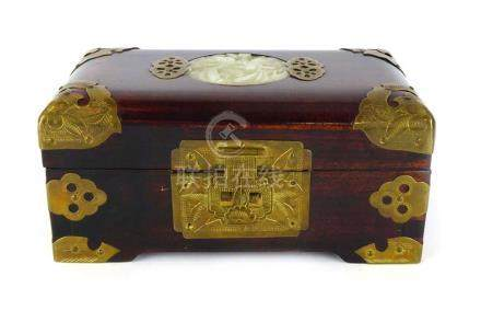 A mid-20th century Chinese brass metal mounted casket centrally inset with a carved jade roundel