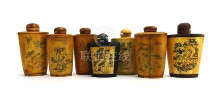 A collection of fourteen mid 20th century bone and other snuff bottles,