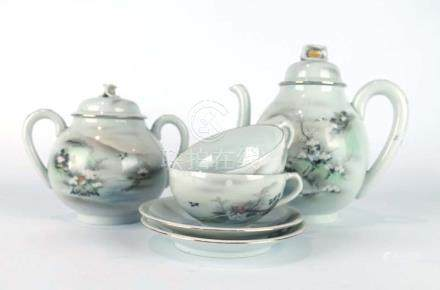 An early/mid 20th century Japanese eggshell porcelain tea service typically decorated with birds