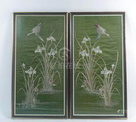 A pair of early 20th century Japanese longstitch embroideries depicting cranes amongst irises on a