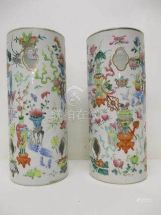 A pair of late 19th century Chinese famille rose cylindrical hat stands with pierced lobed panels,
