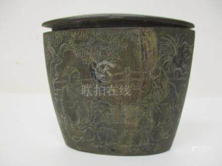 A 19th century Chinese horn pot of ovoid tapered form with a hinged lid and belt clasp carved with