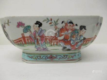 A 20th century Chinese famille rose bowl of square form with inverted corners, on a splayed foot,