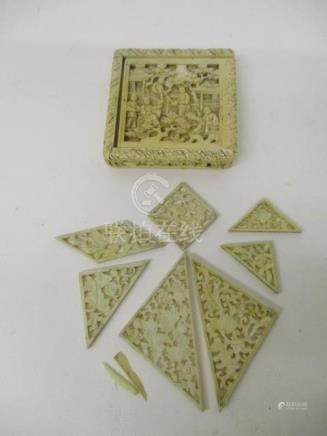A late 19th century Chinese Canton carved ivory puzzle, the box decorated with figures, trees and