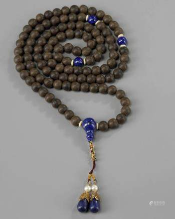 A string of Chinese aloeswood prayer beads
