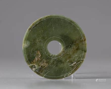 A spinach green jade Bi disc