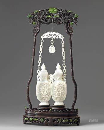 A Chinese white hardstone double vase with a carved wood stand