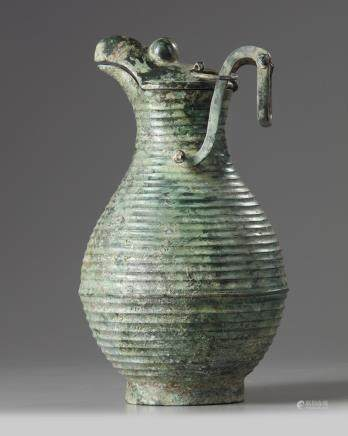 A large Chinese bronze hinged ewer and cover
